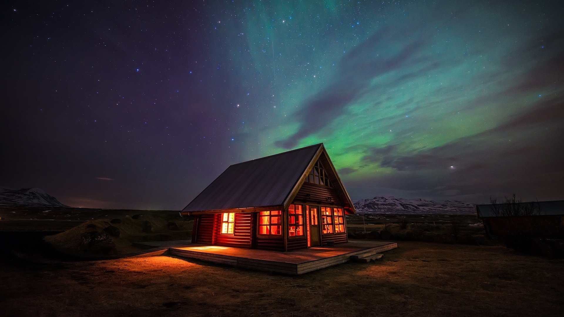 Northern Lights over Lighted House HD
