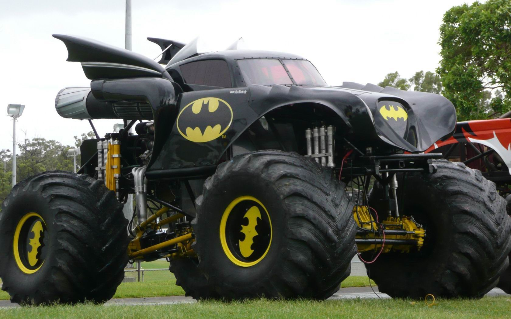 Monster truck wallpaper and background image 1680x1050 id296730 vehicles monster truck batman wallpaper voltagebd Image collections