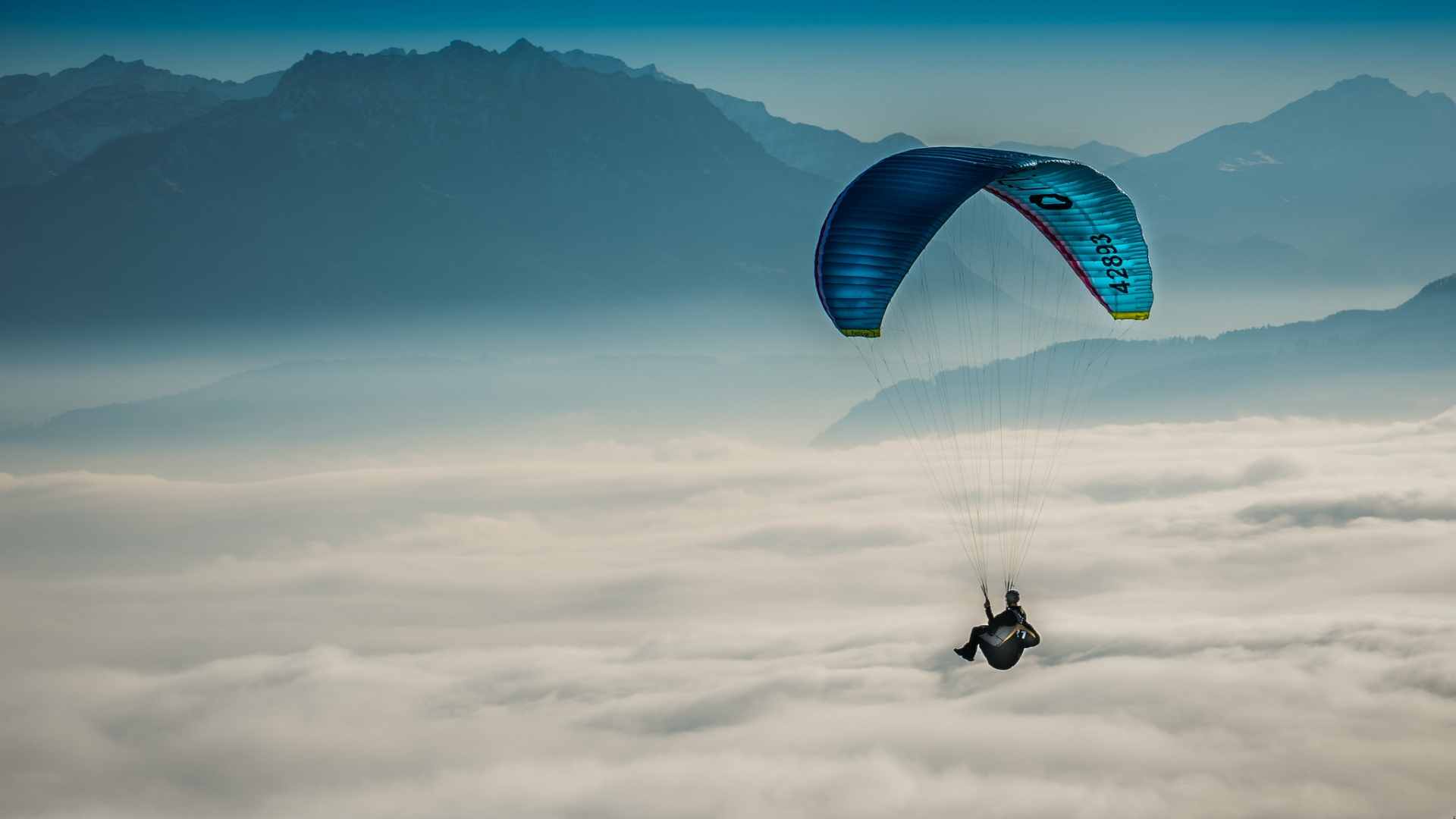 Hang Gliding Above The Clouds HD Wallpaper